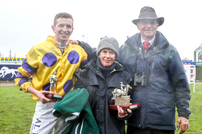 Shaun Phelan with Anne and Harvey Wilson as they pose with the winning trophy for Saturday's Racecourse Hotel & Motor Lodge Grand National Steeplechase - Click Image To Play